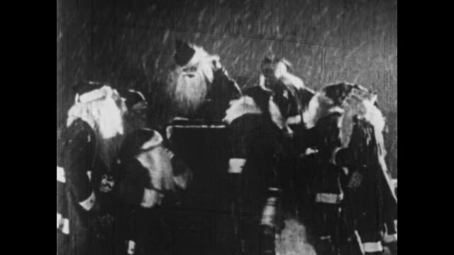 1926 a posse of santas escape from the police down a chimney - 1926 stock videos and b-roll footage