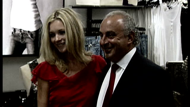 possibility of merger between three london councils mooted r30040703 london oxford street topshop sir philip green posing for photocall with kate... - monopoly chance stock videos & royalty-free footage