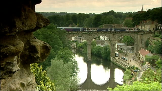 possibility of scrapping child benefit for better off families england north yorkshire knaresborough ext train along over viaduct over river nidd... - knaresborough stock videos & royalty-free footage