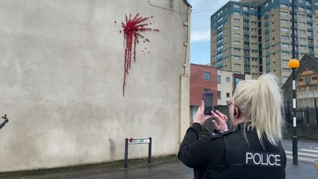 possible banksy mural to mark valentine's day appears in bristol england bristol ext various of possible valentine's day mural on the side of a house... - valentines day stock videos & royalty-free footage