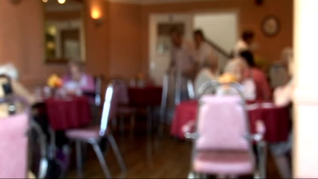 possible cuts in care home and nursing home provision dates locations unknown focus shot of residents in dining room of care home close shots of tea... - dining room stock videos & royalty-free footage