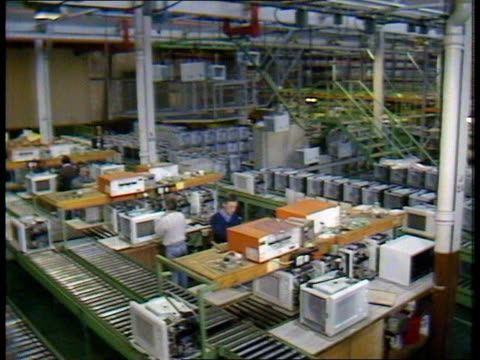 possible recession itn lib luton tgv factory floor with workers and micro waves on production lines tms workers and microwaves tms microwaves moving... - recession stock videos & royalty-free footage