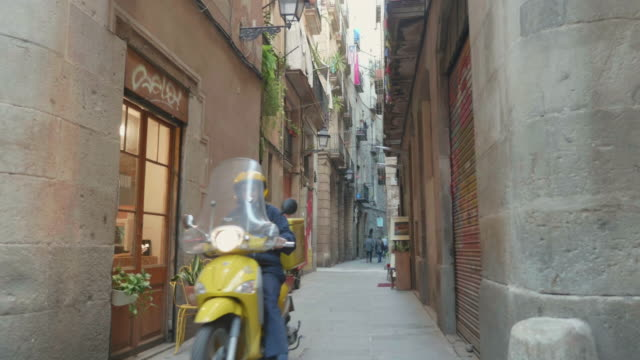 a post motorbike riding inside barcelona gothic district in narrow streets - narrow stock videos and b-roll footage