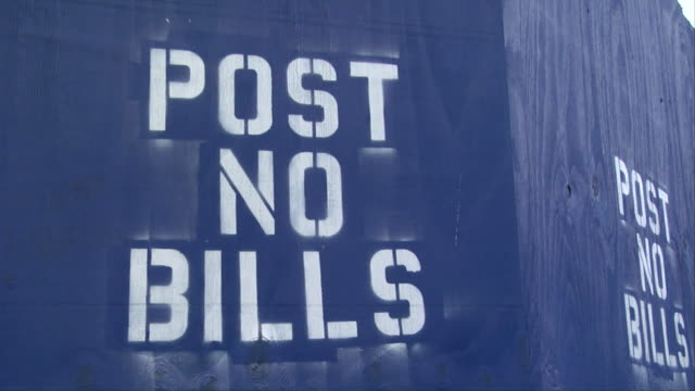 cu 'post no bills' stencil sprayed on blue wall / new york, new york, usa - stencil stock videos & royalty-free footage