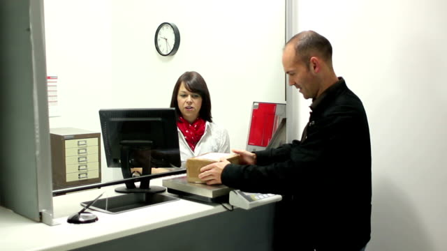 post office - mailing a parcel - sending stock videos and b-roll footage