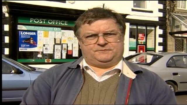 post office protestors present petition to parliament; derbyshire: chapel-en-le-frith: vox pop post office customer - ダービーシャー点の映像素材/bロール