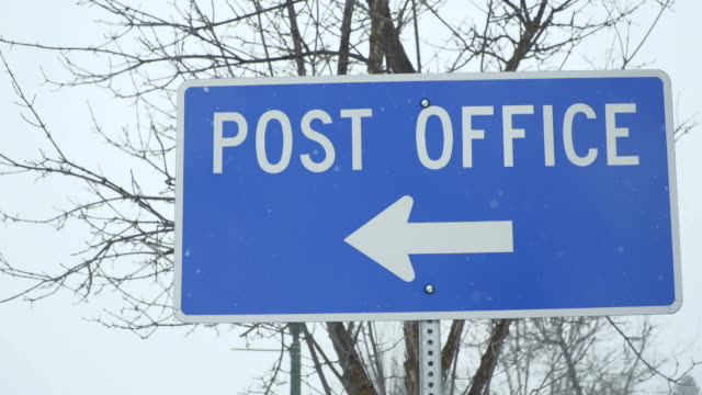 post office sign in the snow - post office stock videos and b-roll footage
