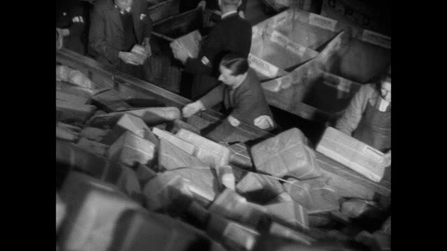 montage post office workers sorting mail and christmas carolers singing in city / england, united kingdom - postal worker stock videos and b-roll footage