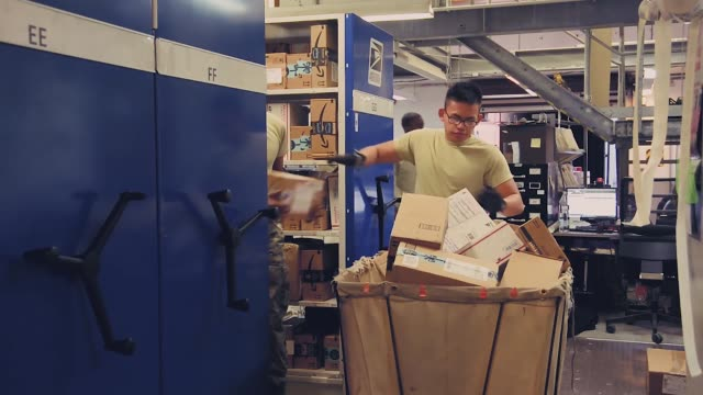 post office workers unloading packages and sorting mail at spangdahlem air base germany - post structure stock videos & royalty-free footage