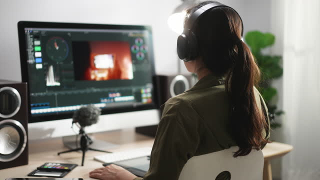 post production - woman video editor doing video editing on computer with headphones - editor stock videos & royalty-free footage