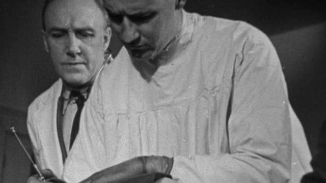 1943 montage post surgery tuberculin patient being given local anesthetic by medical team, and then patient being wheeled to recovery room / united kingdom - tuberculosis stock videos & royalty-free footage