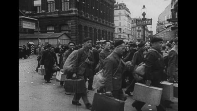 post world war ii / european theater / french language / aerial of large group of men and tents / french soldiers walking through town streets / men... - french army stock videos & royalty-free footage