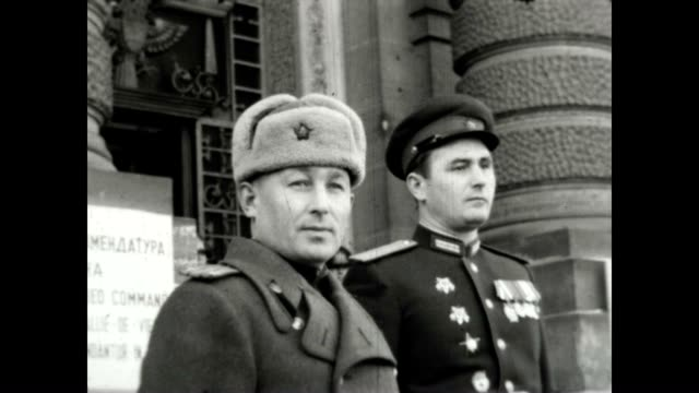 post wwii vienna had a shared security agreement between the soviet and american forces. / every few months there was a rotation of the guards at the... - guerra fredda video stock e b–roll