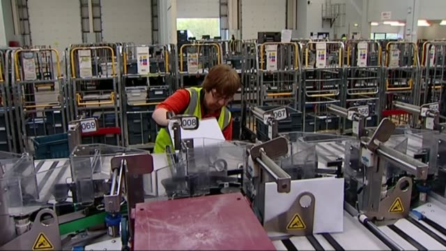 postal group whistl suspends deliveries in manchester liverpool and west london lib balham int staff at work in sorting office - mail stock videos and b-roll footage