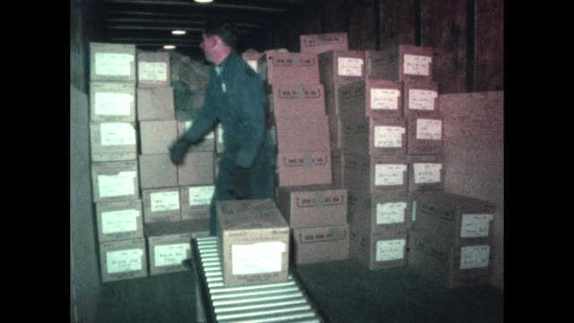 us postal service mail loaded onto truck interview about heavy holiday tax mail - 1960 stock-videos und b-roll-filmmaterial