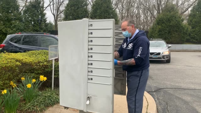 postal service worker lou martini goes about his daily delivery route during the coronavirus pandemic on april 15, 2020 in kings park, new york.... - united states postal service stock videos & royalty-free footage