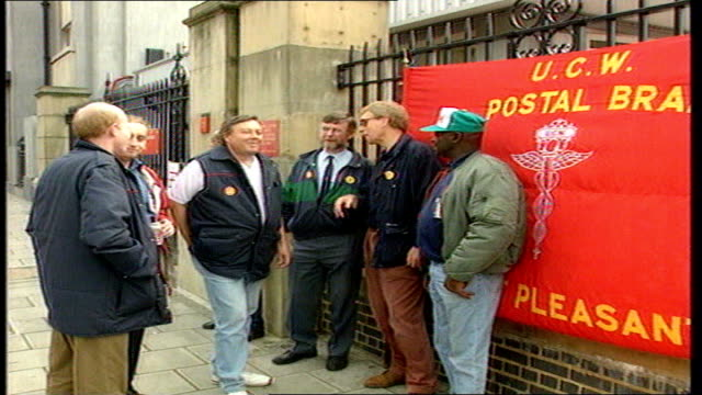 vídeos y material grabado en eventos de stock de postal strike planned for 29 june tx ext demonstrating postal workers some with placard - placard