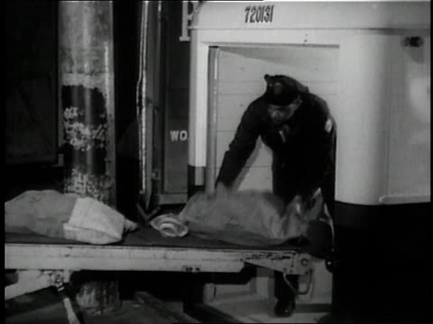 1957 ms postal worker loading sacks of mail onto conveyor belt / detroit, michigan, united states - post structure stock videos & royalty-free footage
