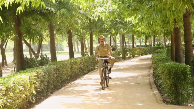 Postal worker riding a bicycle, Delhi, India