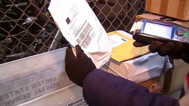 postal worker scanning packages on december 15, 2013 in chicago, illinois - postal worker stock videos & royalty-free footage