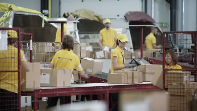 Postal workers busy unloading aircraft shipping containers