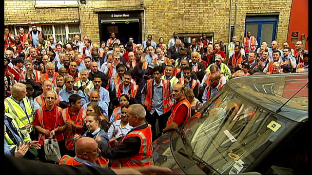Postal workers' dispute managers expected to provide cover for striking workers T31070905 Royal Mail workers gathered in street and applauding...
