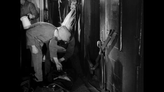MONTAGE Postal workers readying mail bags for pickup aboard the postal special train / United Kingdom