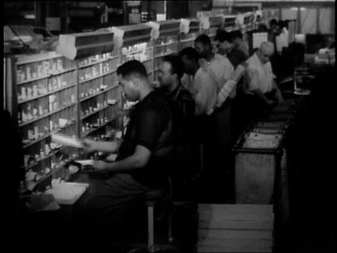 1957 montage postal workers sorting mail / united states - united states postal service stock videos & royalty-free footage