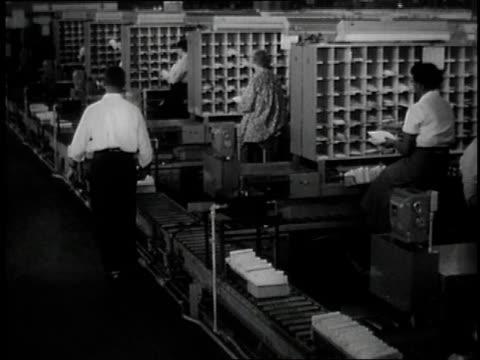 vídeos y material grabado en eventos de stock de 1957 ms postal workers sorting mail / united states - 1957