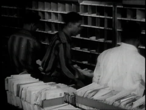 1957 ms postal workers sorting mail / united states - postal worker stock videos & royalty-free footage