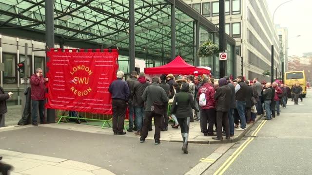 postal workers stage demonstration; england: london: ext gvs postal workers demonstration outside department for business with man dressed as santa,... - fake snow stock videos & royalty-free footage