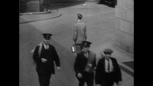 montage postal workers walking in uniform on city street, at work, and sorting mail in long bin / england, united kingdom - post structure stock videos & royalty-free footage