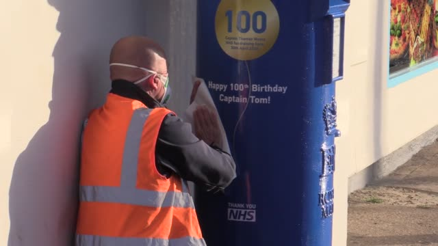 a postbox outside the post office in captain tom moore's village of marston moretaine in bedfordshire has been painted nhs blue in honour of his... - captain tom moore stock videos & royalty-free footage