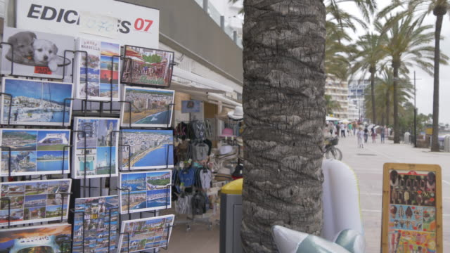 Postcard stand and shops on Paseo Maritimo, Marbella, Andalucia, Spain, Europe