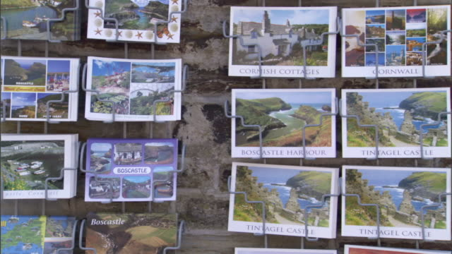 Postcards on display show pictures of Boscastle, England, and its harbor.
