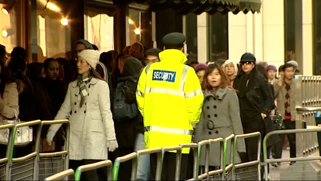 post-christmas sales begin; knightsbridge: ext long queue of shoppers outside harrods store security man on duty beside queue katharine jenkins... - itv london tonight weekend stock videos & royalty-free footage
