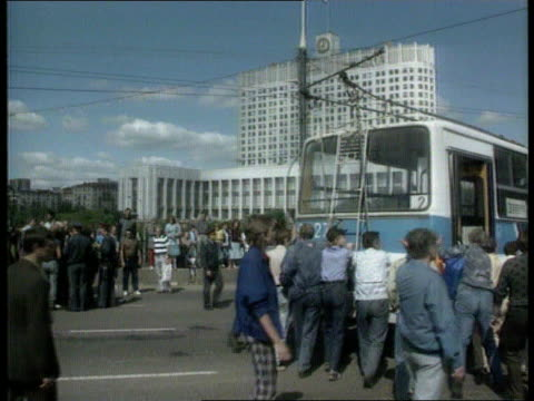 postcoup situation/collapse of the communist party itn bv people pushing bus into position as part of blockade bv ditto bv ditto - communist party stock videos and b-roll footage
