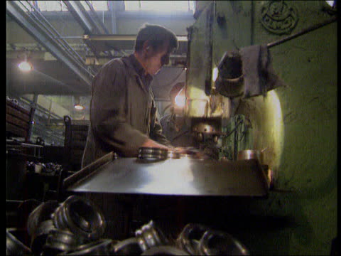 post-coup situation/collapse of the communist party; itn lib ussr int seq men working in factory making metal discs - former soviet union stock videos & royalty-free footage