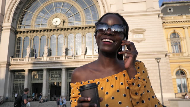 post-covid portrait of millennial african woman with braided hair talking on mobile phone - handheld camera - hungary stock videos & royalty-free footage