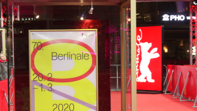 a poster advertises the 70th berlinale international film festival at the zoo palast on february 21 2020 in berlin germany - festival poster stock videos & royalty-free footage