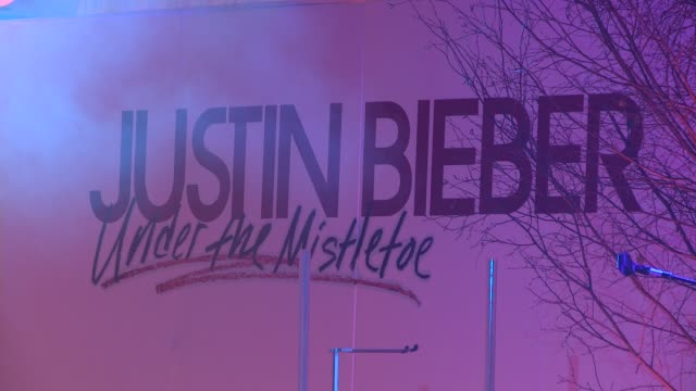 poster at the justin bieber turns on westfield christmas lights at london england - christmas poster stock videos & royalty-free footage