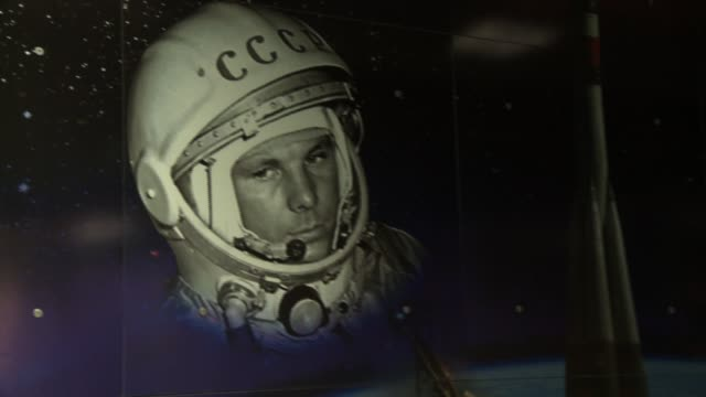 A poster depicts cosmonaut Yuri Gagarin in his space helmet. Available in HD.
