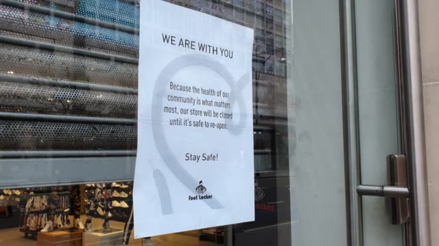 a poster displays the footlocker store on oxford street is closed during the coronavirus pandemic on march 18 2020 in london england - brian dayle coronavirus stock videos & royalty-free footage
