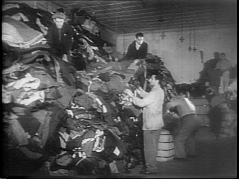 poster for clothing drive / cargo is loaded onto a ship / americans going through their clothes for donation / workers sorting at a warehouse / head... - henry j. kaiser stock videos and b-roll footage