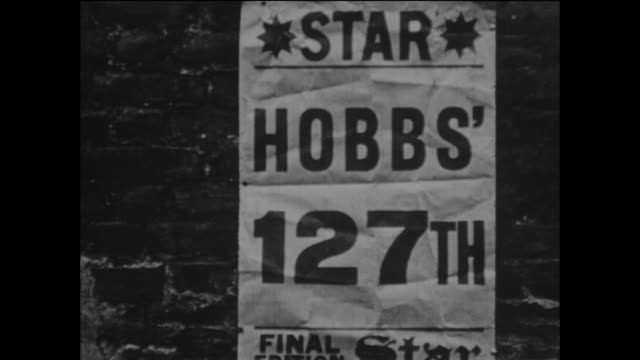 poster for the the star newspaper announcing that jack hobbs had scored his 127th first class century in the county championship match against... - scoring stock videos & royalty-free footage