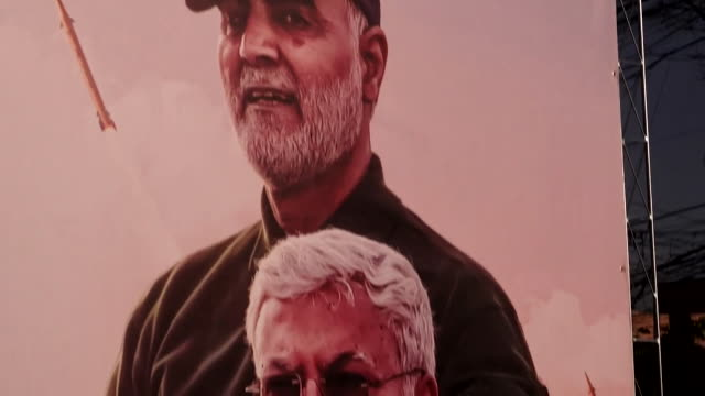 poster of killed iranian general qasem soleimani and iraqi militia leader abu mahdi almuhandis at memorial in baghdad - poster stock videos & royalty-free footage