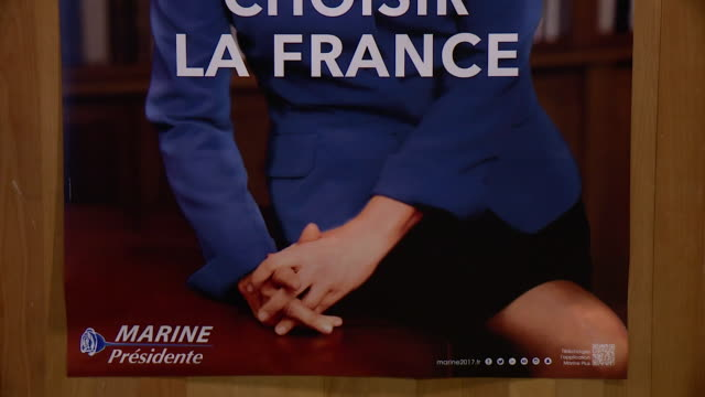 a poster of marine le pen at at a political rally in the run up to the french presidential election reading 'choose france' - poster stock videos & royalty-free footage