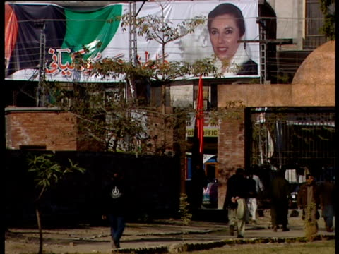 poster of pakistan's former prime minister benazir bhutto in a street of pakistan - poster stock videos & royalty-free footage