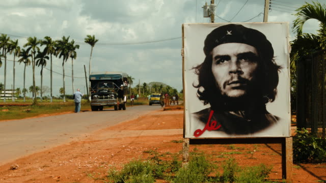 a poster of revolutionary hero che guevara is seen next to the road a day after the second round of diplomatic talks between the united states and... - che guevara stock videos & royalty-free footage