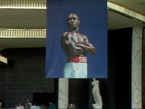 a poster of the sugar ray leonard hangs over the caesars palace entrance advertising his fight with don lalonde in november 1988 - casino poster stock videos & royalty-free footage